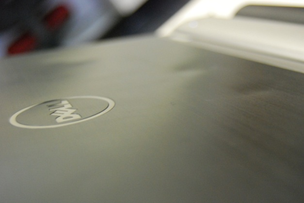 Dell Logo on dented laptop